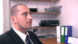 Scary Looking Business Man Looking Up Smiling stock footage
