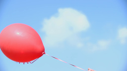 Slow Motion Red Balloon With Hellium Flying In Sky stock footage