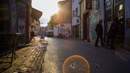 Sunset On Street With Couple Slowly Walking stock footage