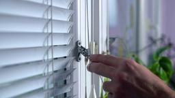 Close Up Pulling Up Blinds At Home Slow Motion stock footage