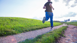 Young Man Running In Slow Motion At Sunset stock footage