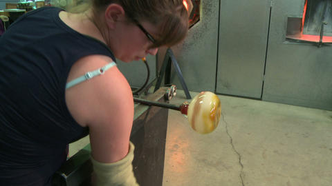 Glass blower shaping hot glass Live Action
