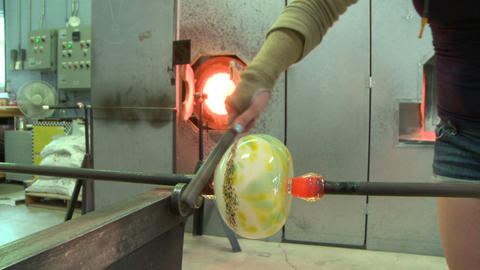 Glass blower working in studio Live Action