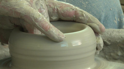 Potter starting a clay vase, close up Footage