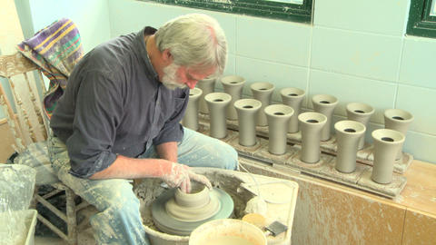 Wide shot potter shaping a tall vase Footage