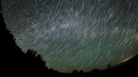 Time lapse of stars behind mountain Footage