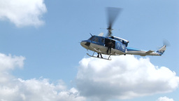 Special Police Helicopter Dropping Two Armed Man stock footage