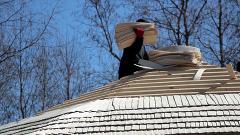 Man working Cedar wooden shingles roof roofing roo Live Action