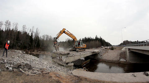 Bulldozer destroying a bridge backhoe working on t Footage