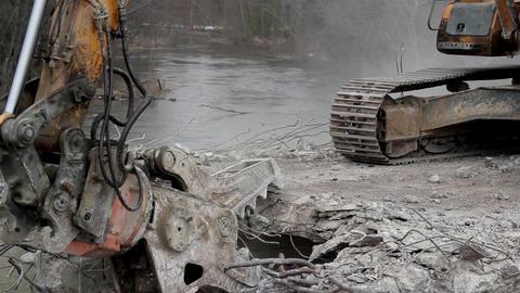 Bulldozer destroying a bridges heavy equipment wit Footage