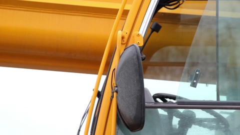 Close Image Of The Side Mirror Of The Yellow Const stock footage