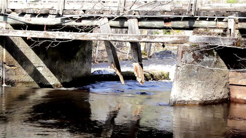 River flowing under the wooden small bridge with s Footage