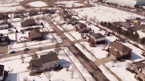 Aerial of homes in a snow covered suburban neighbo Footage