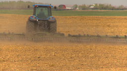 HD2009-5-6-16 tilling fields Stock Video Footage