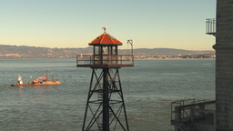 HD2009-11-1-17 barge passes Alcatraz tower Stock Video Footage