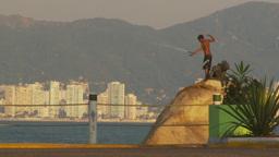 HD2009-11-7-24 Aculpoco boy fishing on rock Stock Video Footage
