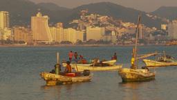 HD2009-11-7-30 Aculpoco bay, skiffs in water condos hotels Stock Video Footage