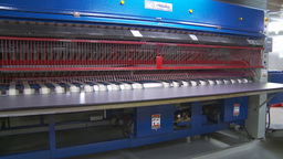 HD2009-11-9-17 industrial laundry machines folding Stock Video Footage