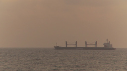 HD2009-11-14-18 distant cargo ship horizon Stock Video Footage