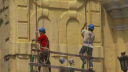 HD2009-11-16-16 men painting bdg Stock Video Footage