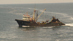 HD2009-11-18-1 fishing boat heading out to sea Stock Video Footage