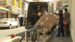 HD2009-11-18-33 Arica unloading crazy amount boxes Stock Video Footage