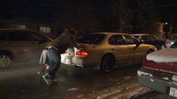 HD2009-11-24-19 snowstorm people pushing cars hopless spin Stock Video Footage