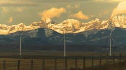 HD2009-10-6-8 wind turbines light on mtns Stock Video Footage