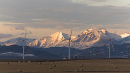 HD2009-10-6-10 wind turbines light on mtns Stock Video Footage