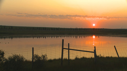HD2009-9-1-1 sunrise over prairie pond Stock Video Footage