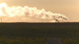 HD2009-9-31-10 pollution exhaust stack over field Stock Video Footage