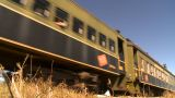 HD2009-9-31-26 Steam Train Passenger Cars Low Angle stock footage