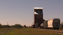 HD2009-9-32-2 grain elevator and train cars Footage