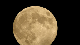 Extreme Close Up Moon Through Dark Clouds stock footage