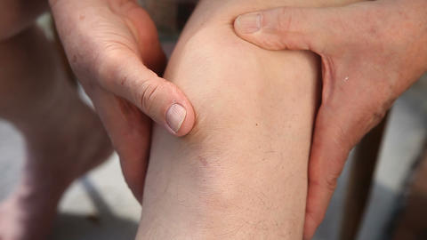 Man Moves His Kneecap Around stock footage