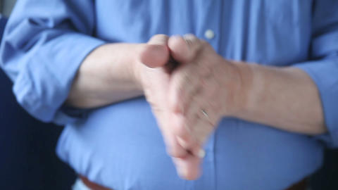 Man Rubbing Hands Together stock footage