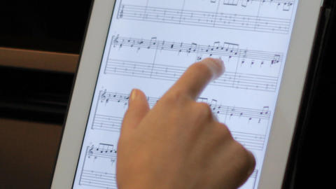 touching tablet computer for the piano sheet music Live Action