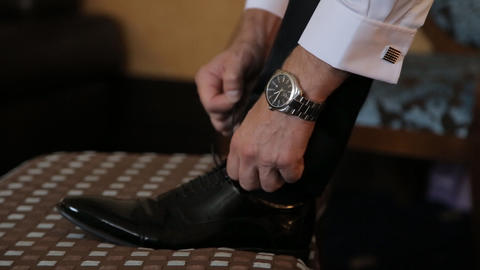Man Han Ds Tying Shoes stock footage