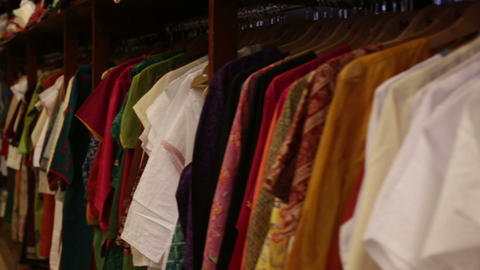 clothes lying on the shelves in the store Live Action