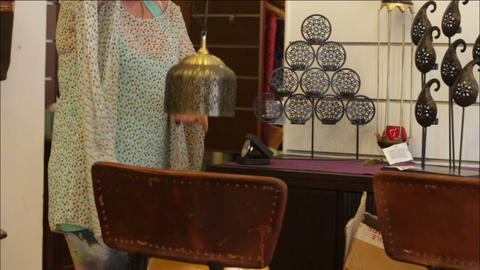 woman chooses decorative accessories in the store Footage