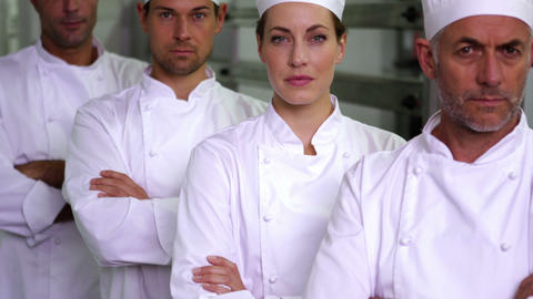 Four stern chefs looking at camera with arms crossed Footage