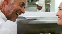 Chef smelling colleagues sauce and smiling at came Footage