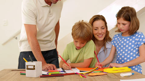Happy parents and children drawing together at the Footage