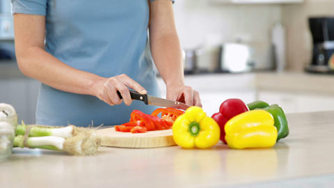 Woman preparing vegetables on the chopping board Footage