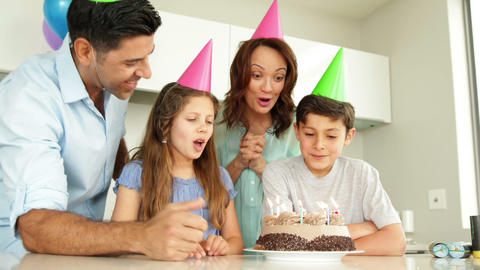 Father lighting candles on birthday cake for his son Live Action