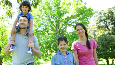 Happy family walking in the park together Footage