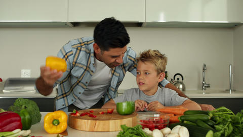 Father showing his son different ingredients Footage