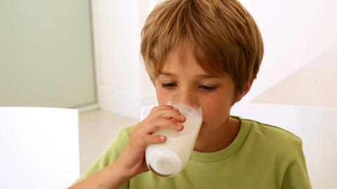 Little boy drinking a glass of milk Footage