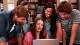 Happy students working together in the library Footage