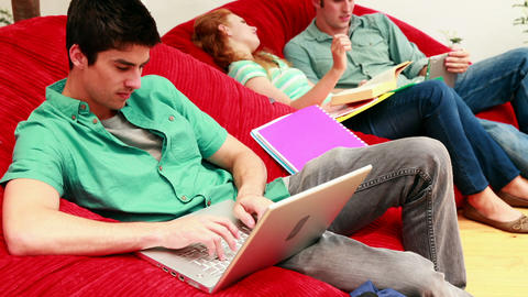 Students studying in the common room on beanbags Footage
